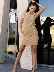 Стильное короткое бежевое платье с карманами и металлическим декором