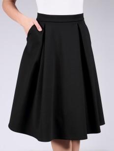 Черная трикотажная юбка миди свободного кроя с карманами